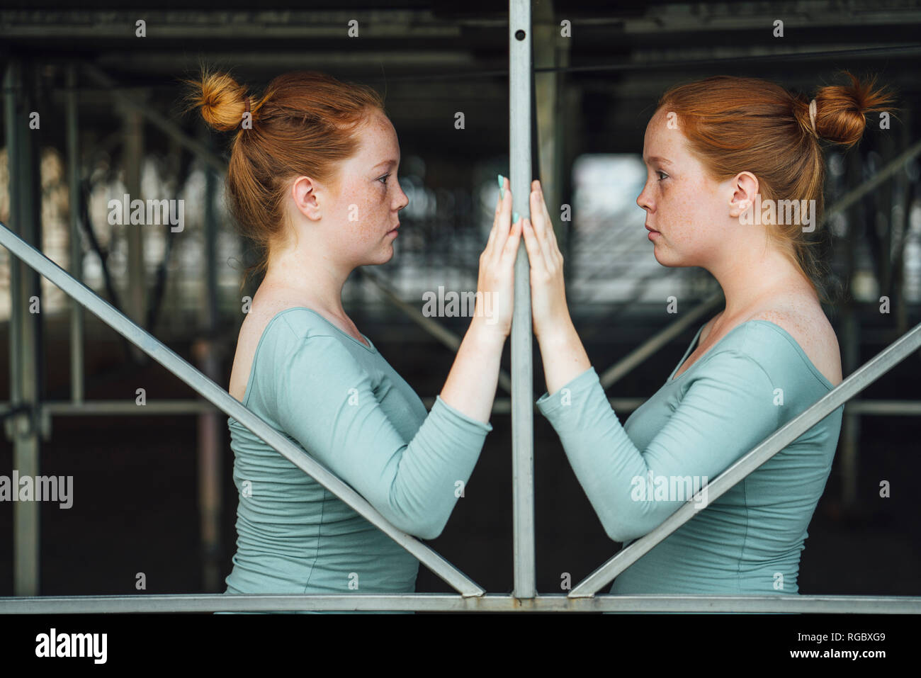 Redheaded twins, face to face - Stock Image