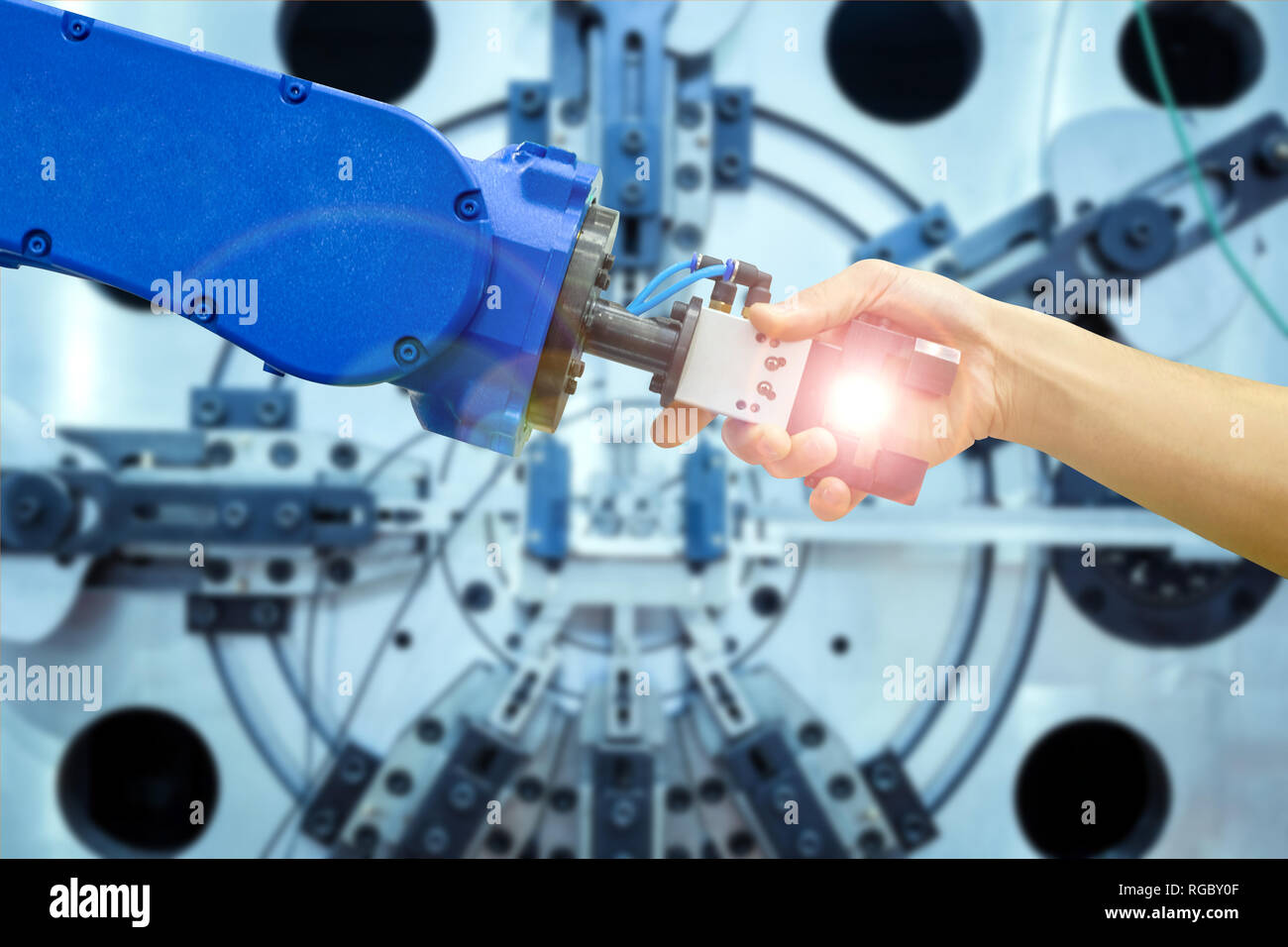 Industrial robot handshake with human on relationship for join to working on industrial manufacturing in concept - Stock Image