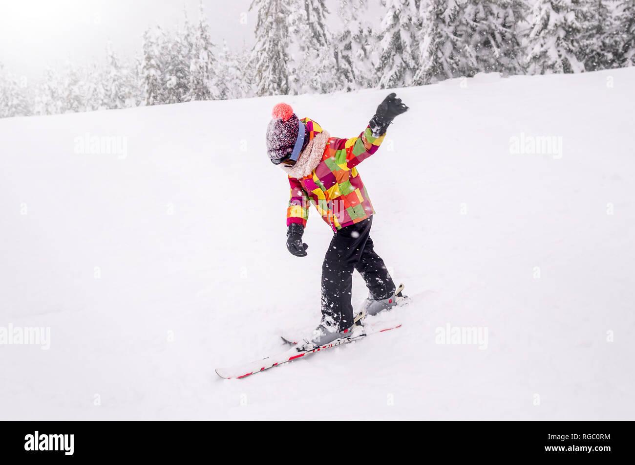 A little boy learn downhill skiing. Kid in ski school. Winter sport for kids. - Stock Image