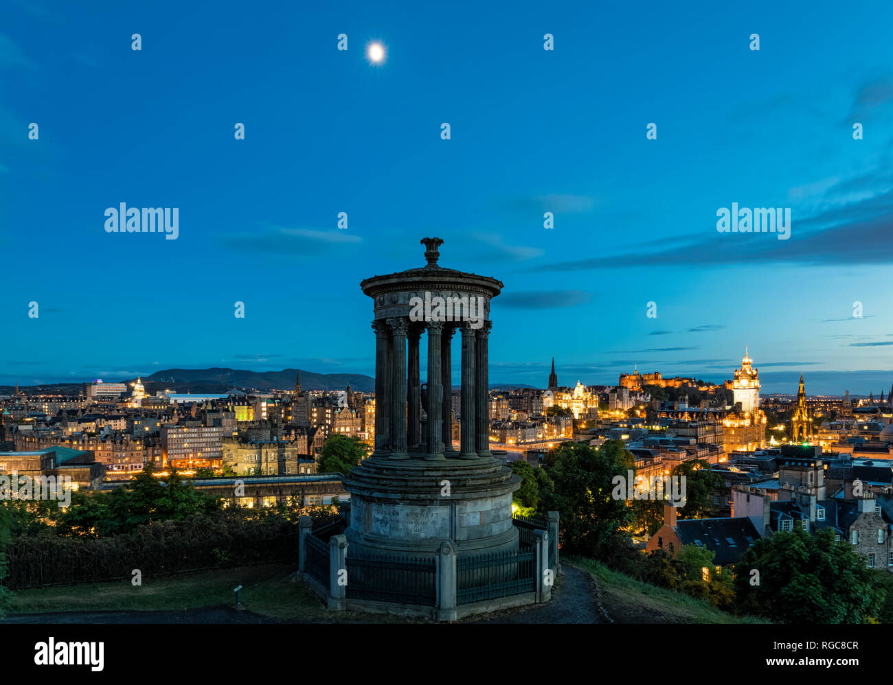 Great Britain, Scotland, Edinburgh, View from Calton Hill with Dugald Stewart Monument, cityscape of old town with castle and Balmoral Hotel Stock Photo