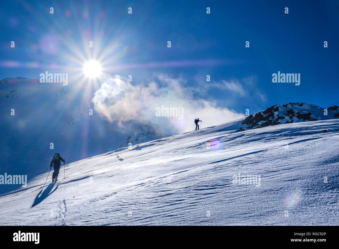 Two men doing a ski tour in Faragas mountains, Southern Carpathians, Romania Stock Photo