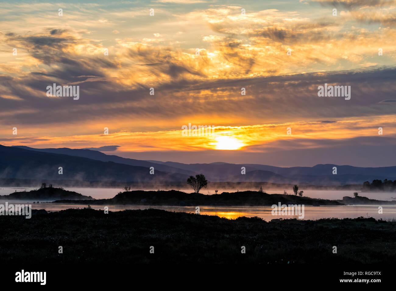 Great Britain, Scotland, Scottish Highlands, Glencoe, Rannoch Moor, Sunrise over Loch Ba - Stock Image