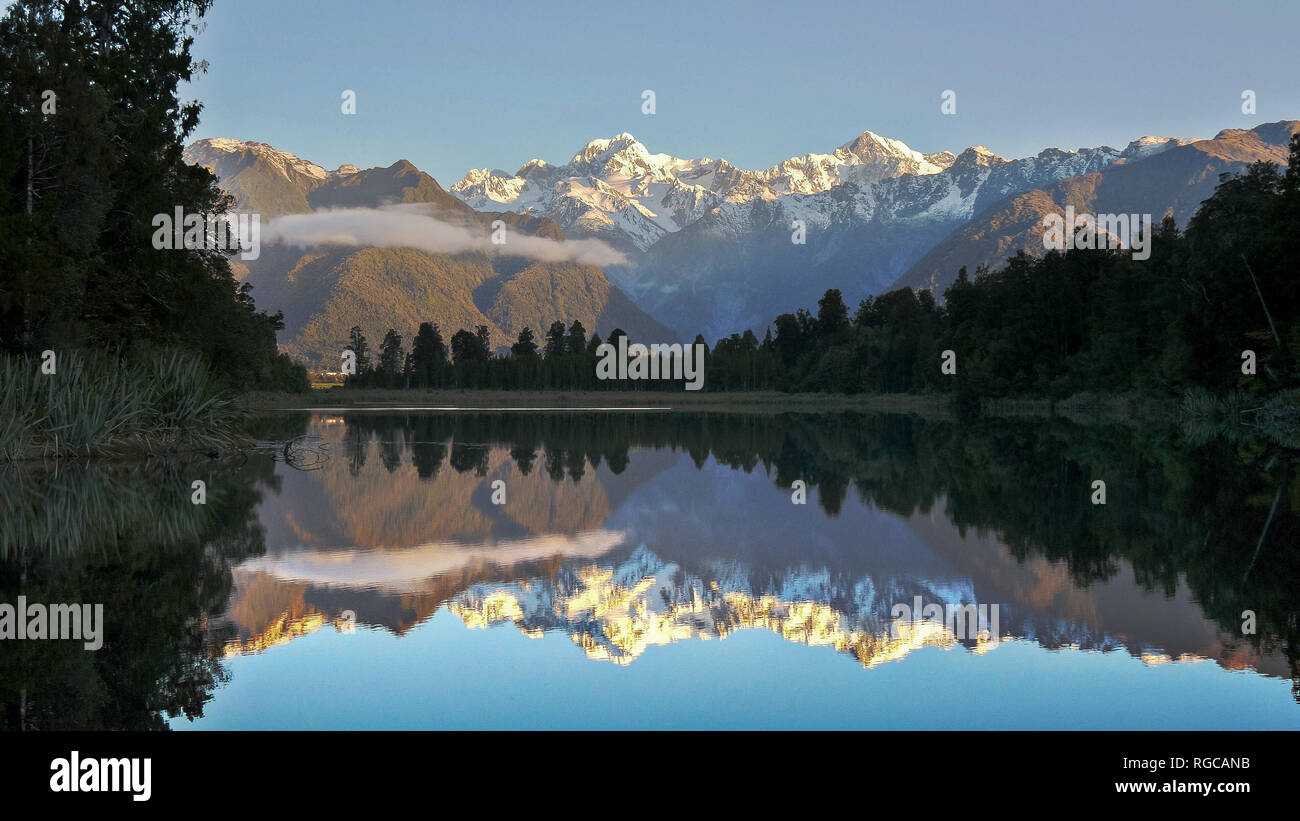 late afternoon shot of mt cook reflected in the waters of lake matheson in new zealand Stock Photo