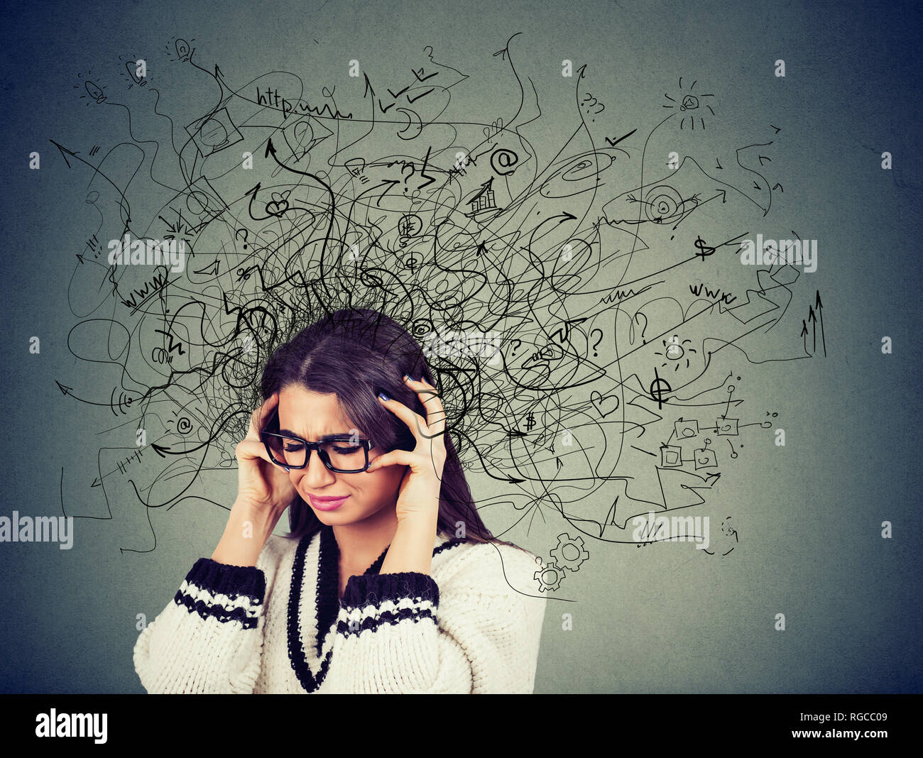 Thoughtful stressed young woman in glasses with a mess in her head feeling anxious - Stock Image