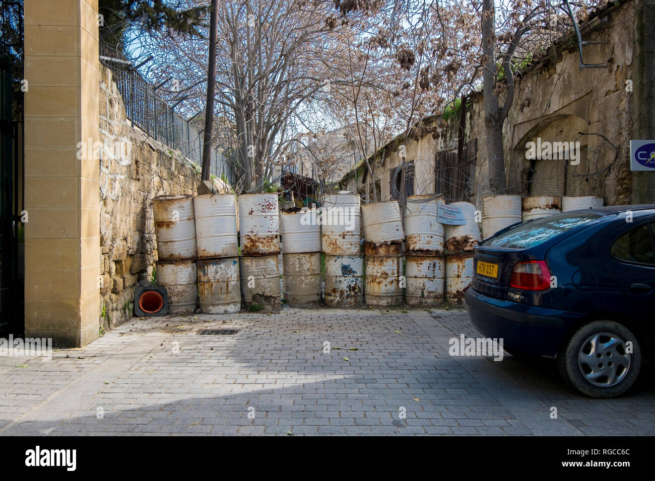 Barrels block passage through the Green Zone that divides Nicosia between the Greek and Turkish sides in Cyprus. - Stock Image
