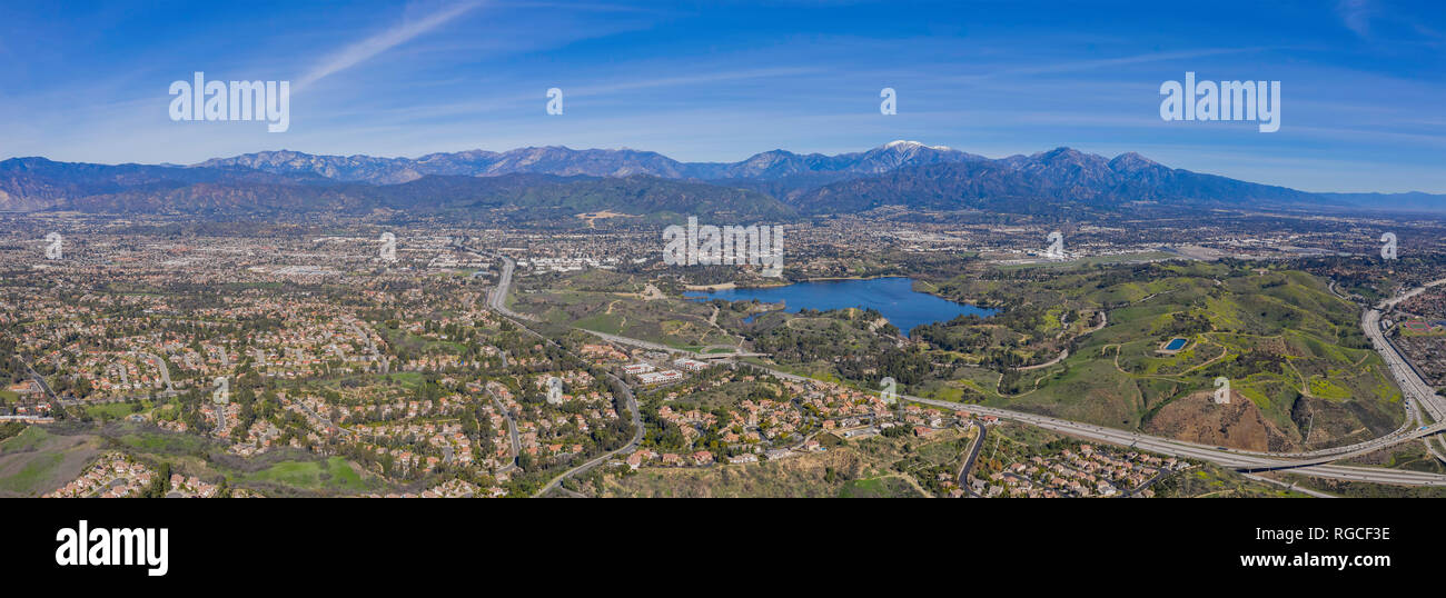 Aerial view of Puddingstone Reservoir with Mt. Baldy as background at California - Stock Image