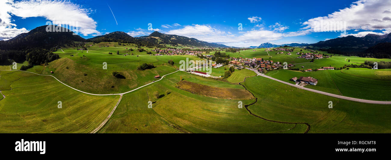 Germany, Bavaria, Swabia, Oberallgaeu, Obermaiselstein and Sonderdorf with fields Stock Photo
