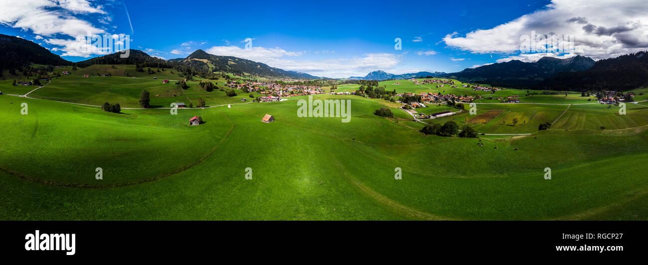 Germany, Bavaria, Swabia, Oberallgaeu, Obermaiselstein and Sonderdorf with fields Stock Photo