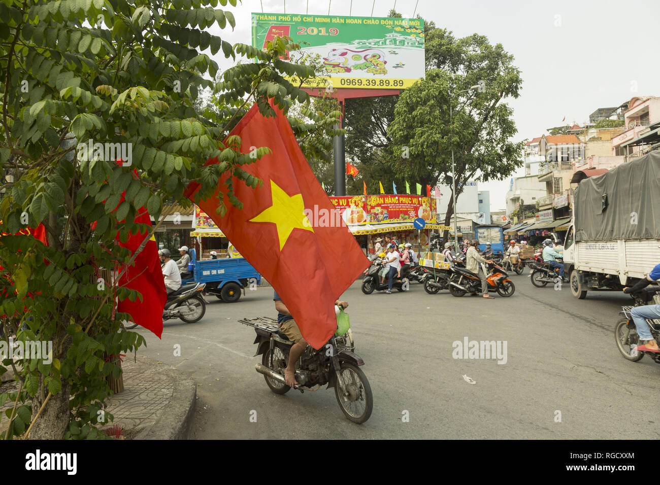 Vietnam flag on the street Ho Chi MInh city in Vietnam - Stock Image