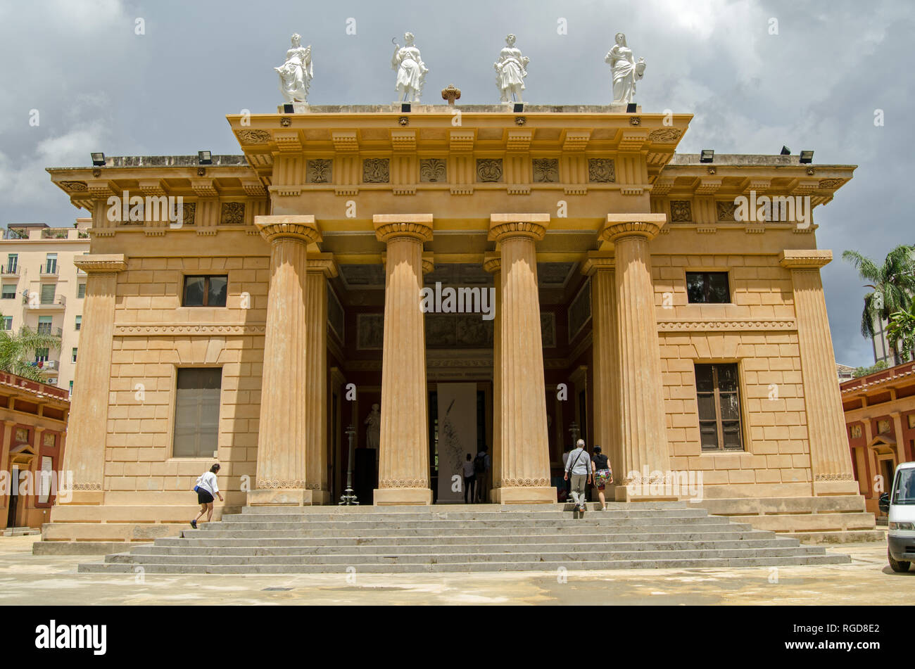 PALERMO, ITALY - JUNE 15, 2018: Visitors entering the classically inspired Gymnasium building at the Botanical Gardens in Palermo, Sicily.  Sunny summ - Stock Image