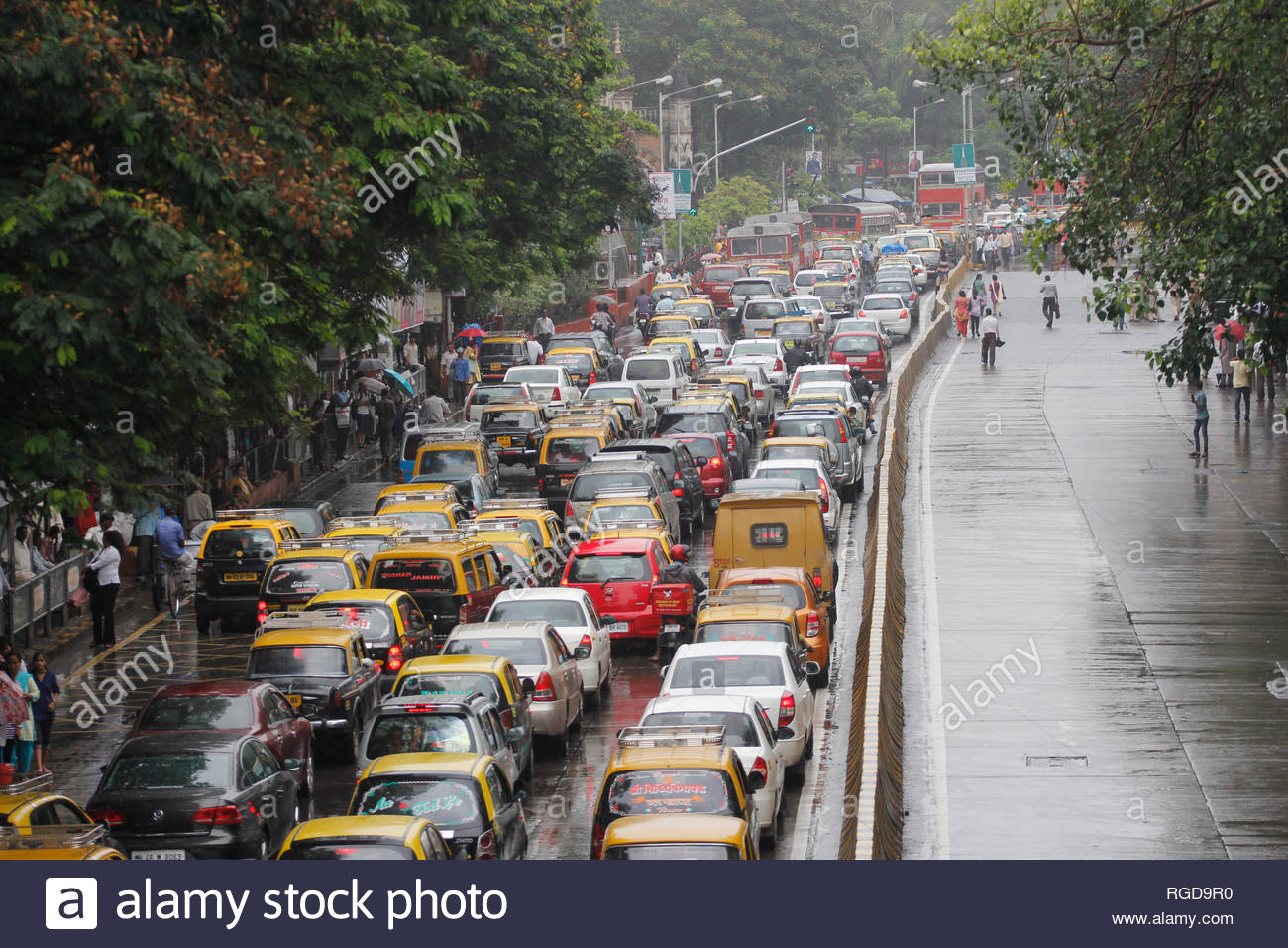 Taxi and Autorickshaw drivers along with workers from various unions protest in demand to increase fare hike in Mumbai, India on June 12, 2013. Auto drivers have warned of an indefinite agitation from June 18. (Rupesh Khot) - Stock Image