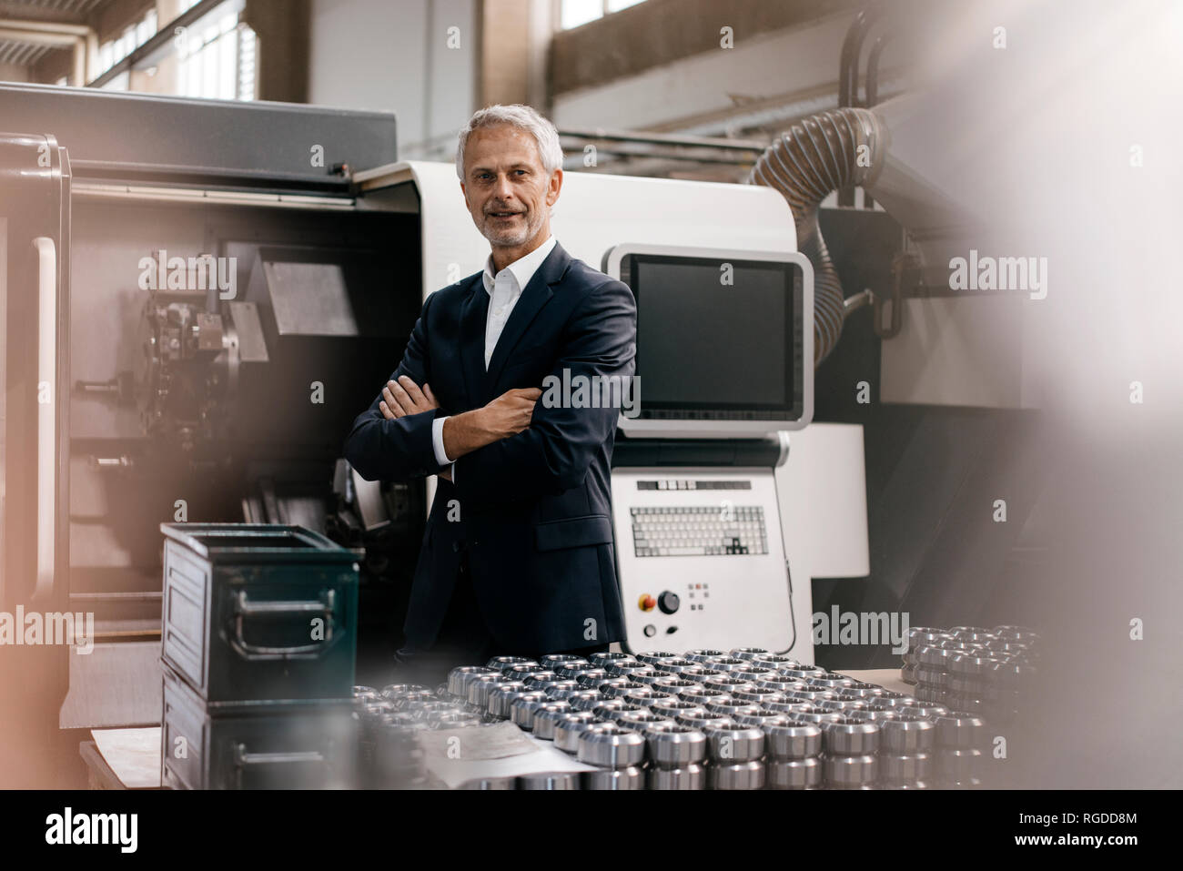 Portrait of a successful entrepreneur in his company - Stock Image