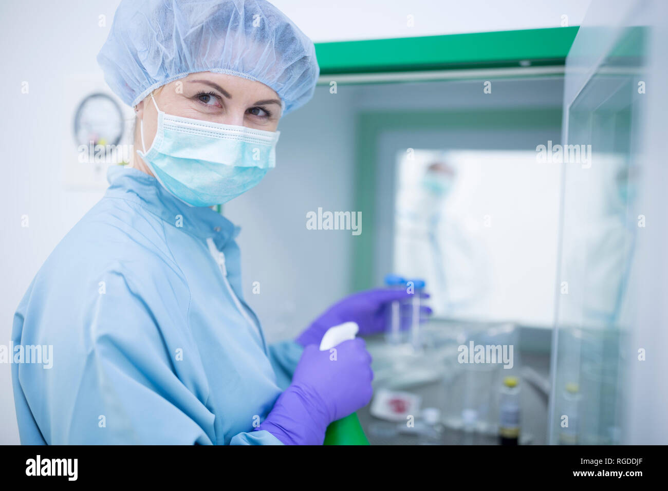 Transfer of material for drug production through material sluice - Stock Image