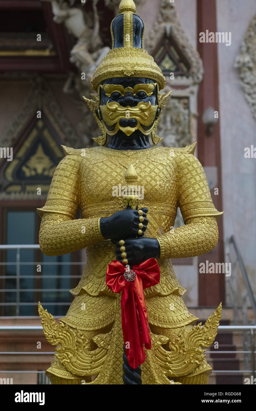 A black Yak or demon figure stands guard at Wat Si Sa Thong (Sisa Thong) near Bangkok, Thailand, dedicated to Rahu, the god of darkness - Stock Image