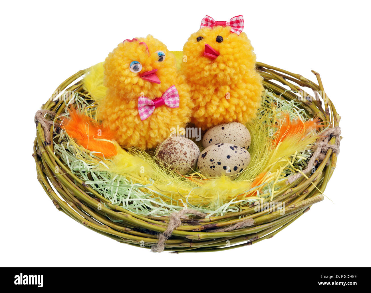 Easter handmade  nest from willow twigs with funny chickens and eggs isolated - Stock Image