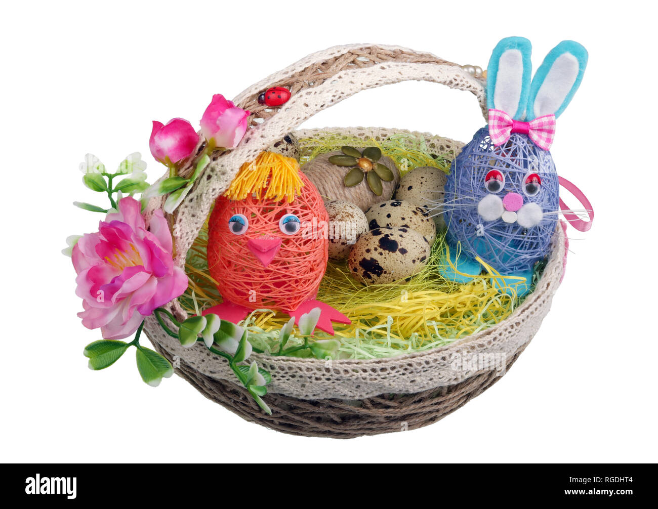 Easter handmade  nest from rope with funny chicken bunny  and eggs. Isolated on white studio macro shot Stock Photo