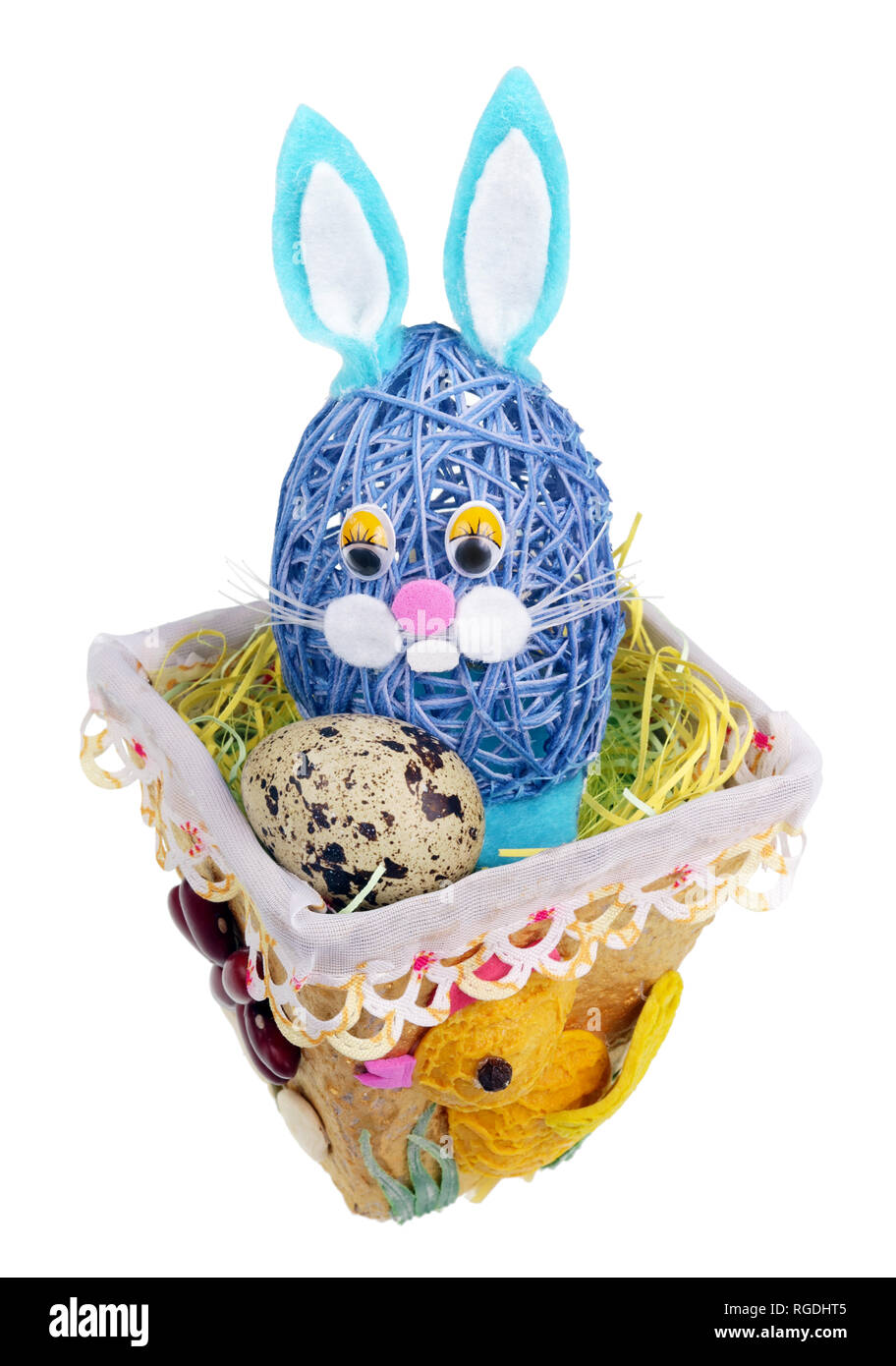 Easter handmade  nest from rope with funny bunny  and  quail egg. Isolated on white studio macro shot Stock Photo
