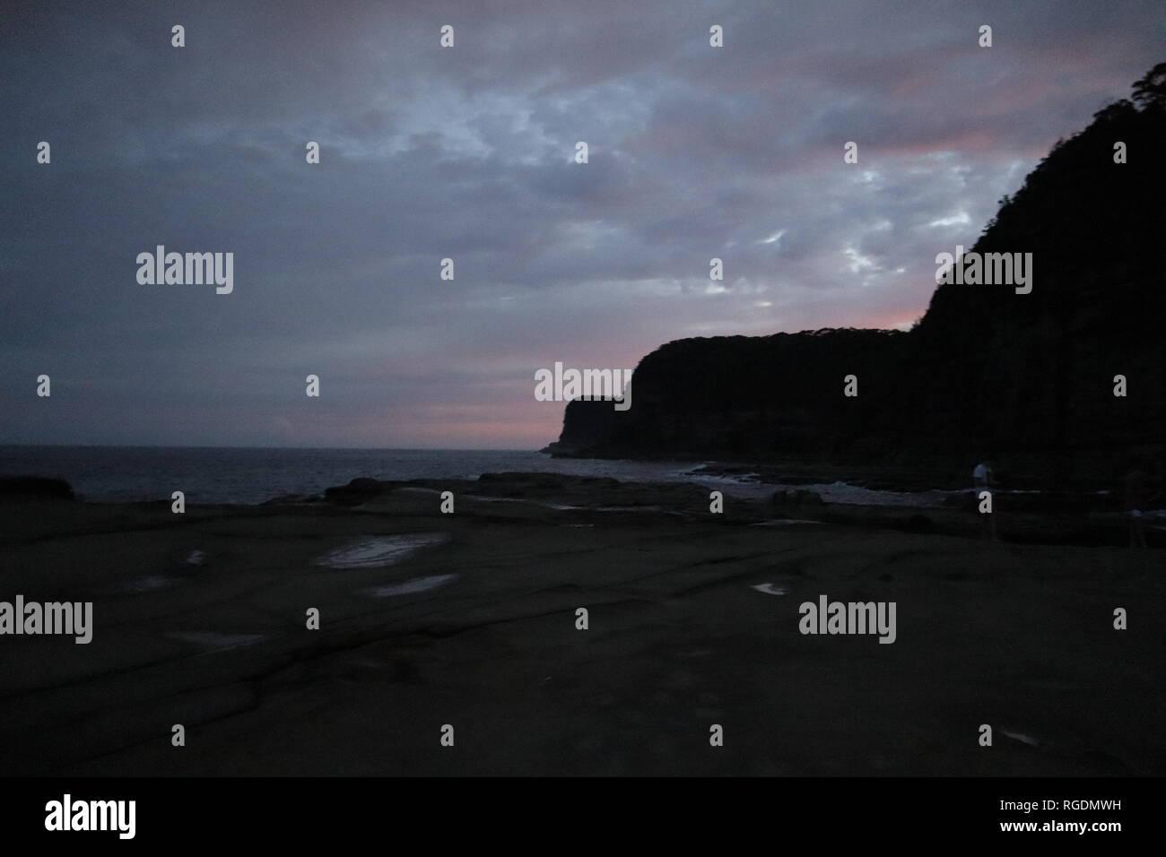 Sunset behind rocks - Stock Image