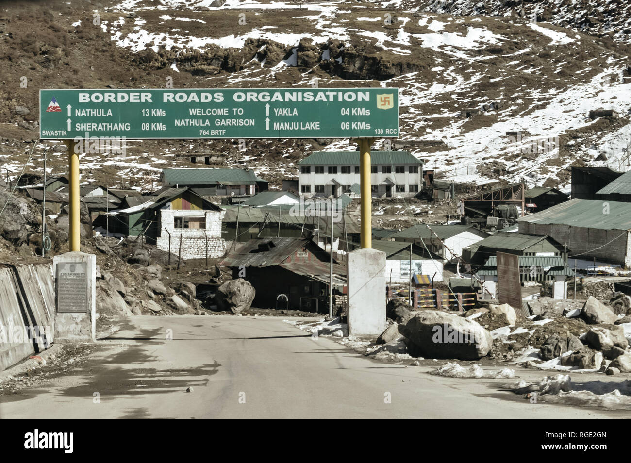 Traffic directional sign board on highway in the entrance of the city near India China border near Nathu La mountain pass in the Himalayas which conne - Stock Image