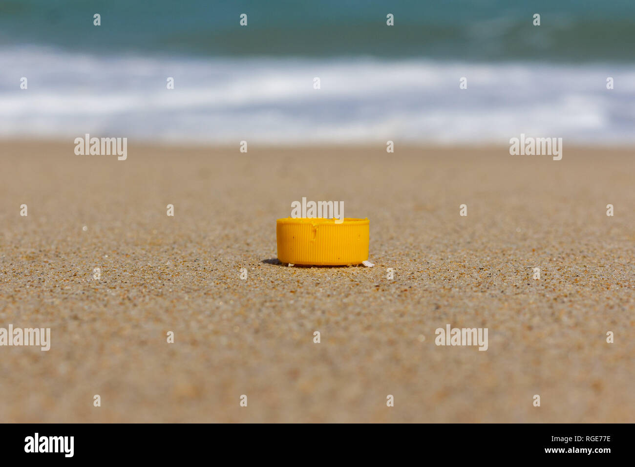 Beach pollution, plastic and waste from ocean on the beach - Stock Image