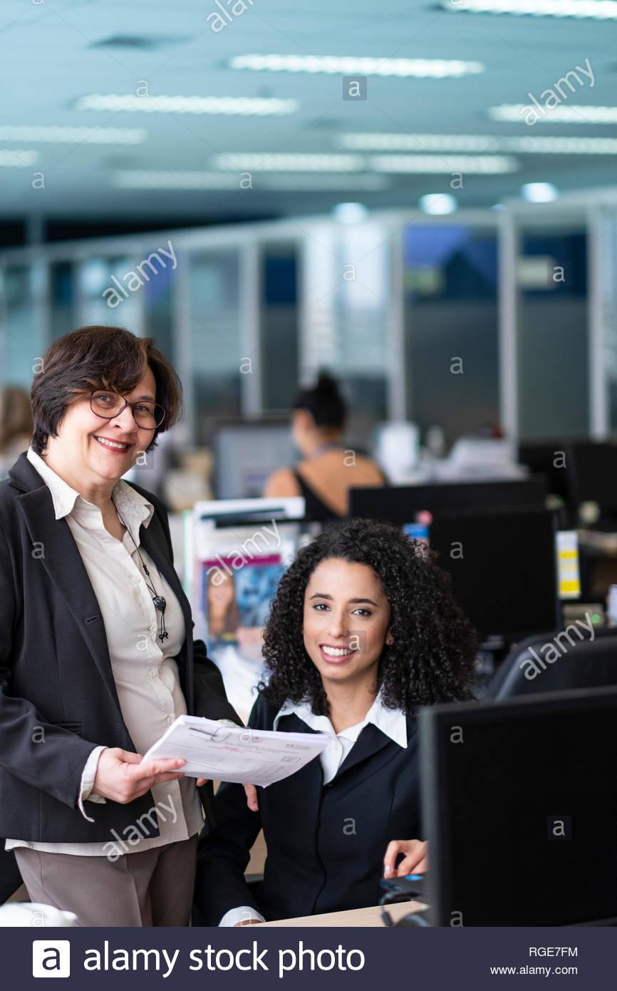 Two Brazilian business women having an informal meeting in an office in Sao Paulo - Stock Image