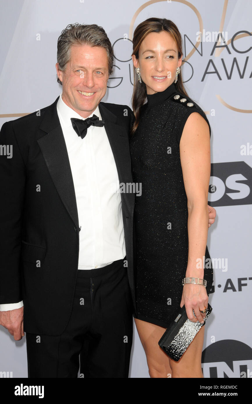 January 27, 2019 - Los Angeles, CA, USA - LOS ANGELES - JAN 27:  Hugh Grant, Anna Elisabet Eberstein at the 25th Annual Screen Actors Guild Awards at the Shrine Auditorium on January 27, 2019 in Los Angeles, CA (Credit Image: © Kay Blake/ZUMA Wire) - Stock Image