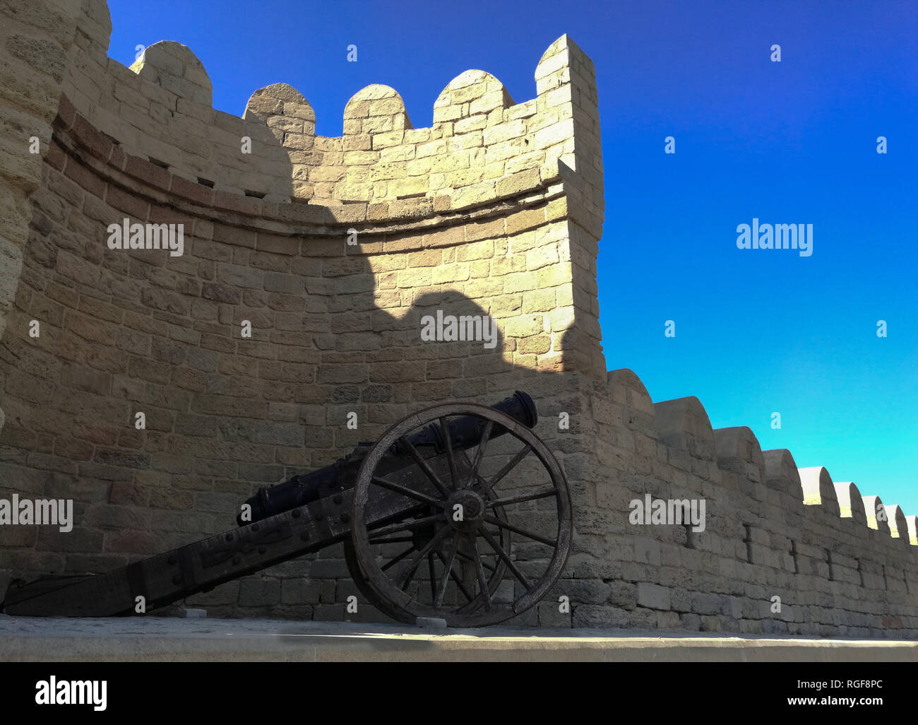 An old canon in old town by the city wall. Old city is a inner city Baku, Azerbaijan rounded by city walls. - Stock Image