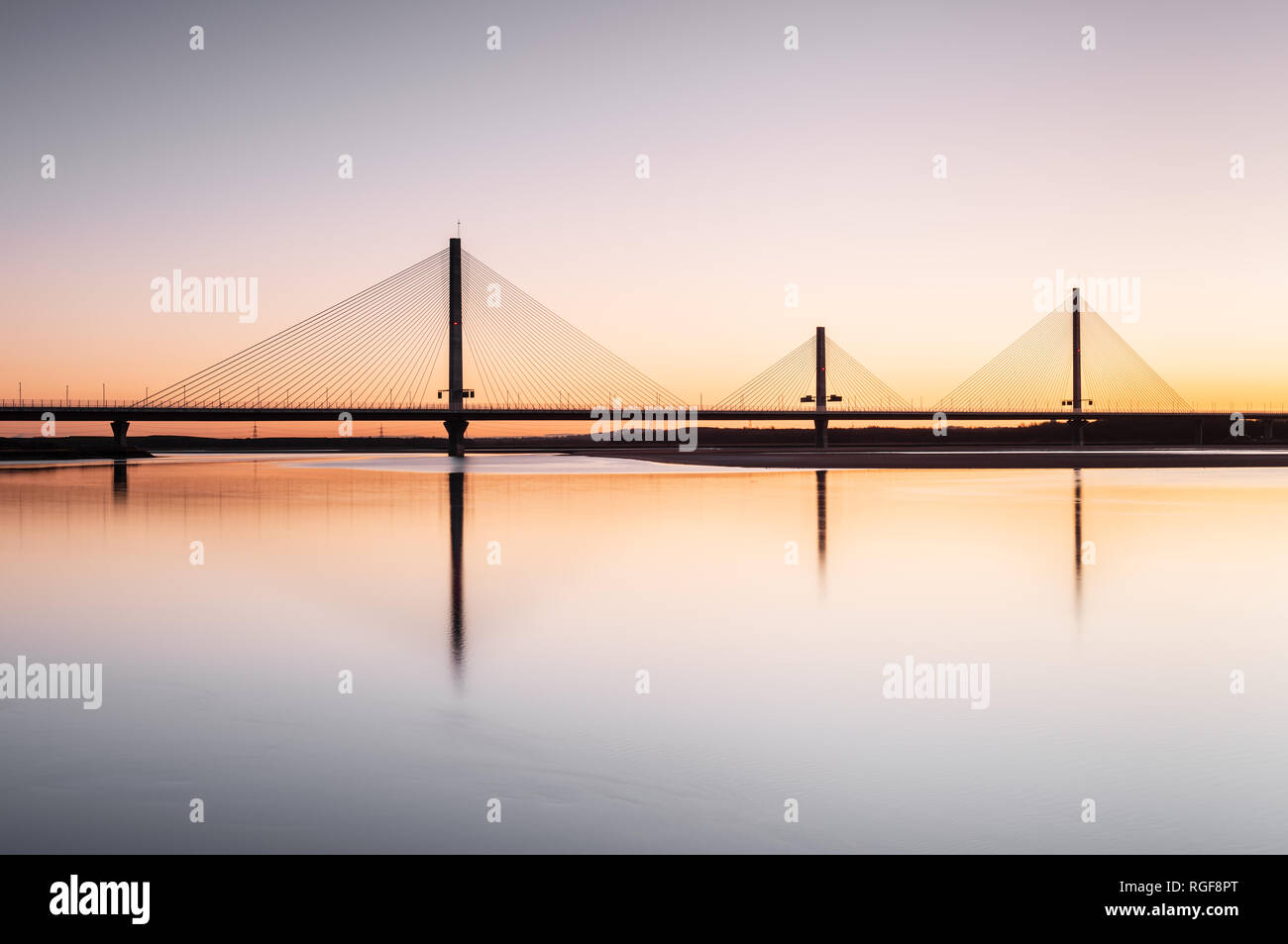 Sunrise view of the Mersey Gateway Bridge over the River Mersey that connects Runcorn and Widnes in Cheshire - Stock Image