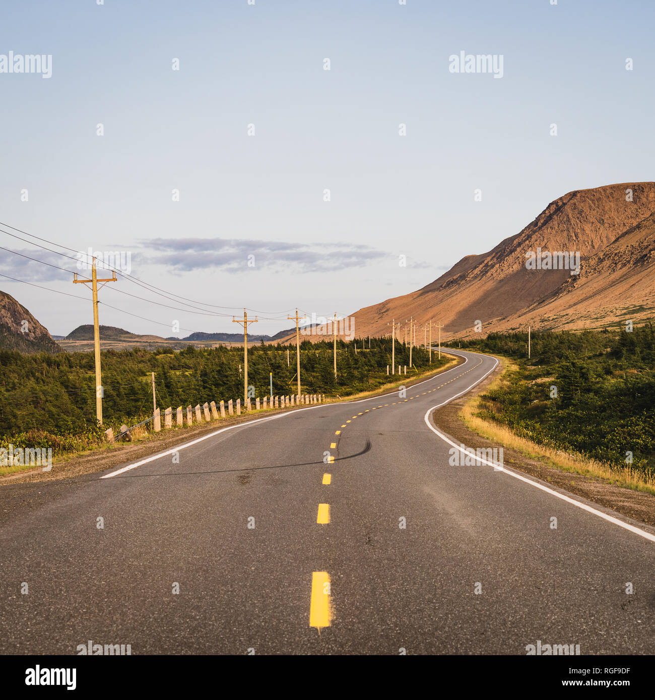 Twisting road running beside the Tablelands in the Gros Morne National Park in Newfoundland, Canada - Stock Image