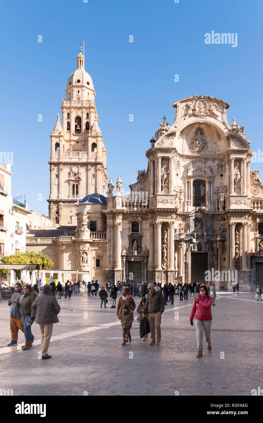 People walking in the Plaza del Cardenal Belluga before Murcia cathedral, Spain, Europe - Stock Image