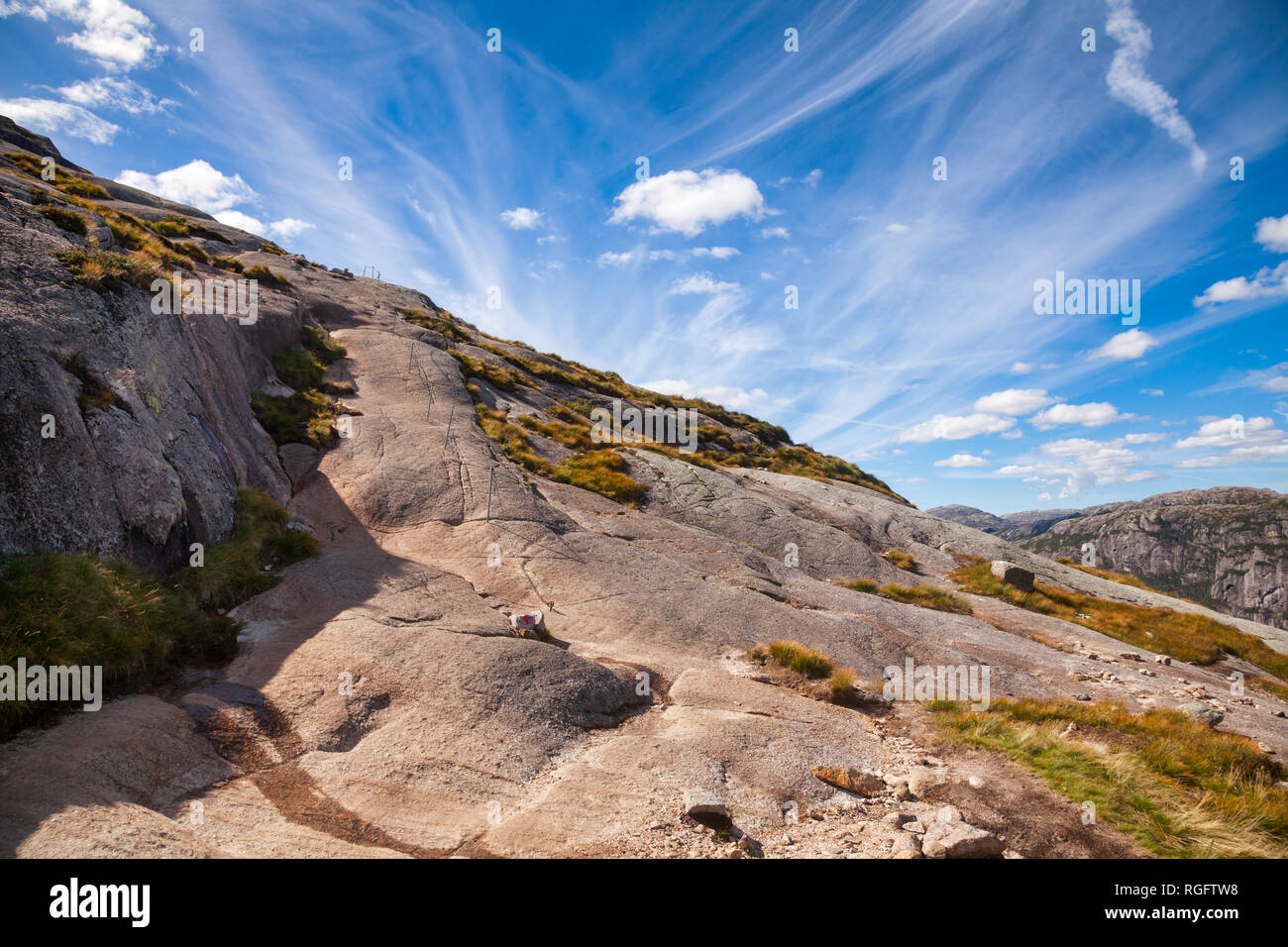 Marked mountain hiking trail along the Lysefjord to Kjeragbolten boulder at Kjerag (or Kiragg) Plateau, a popular travel destination in Forsand munici - Stock Image