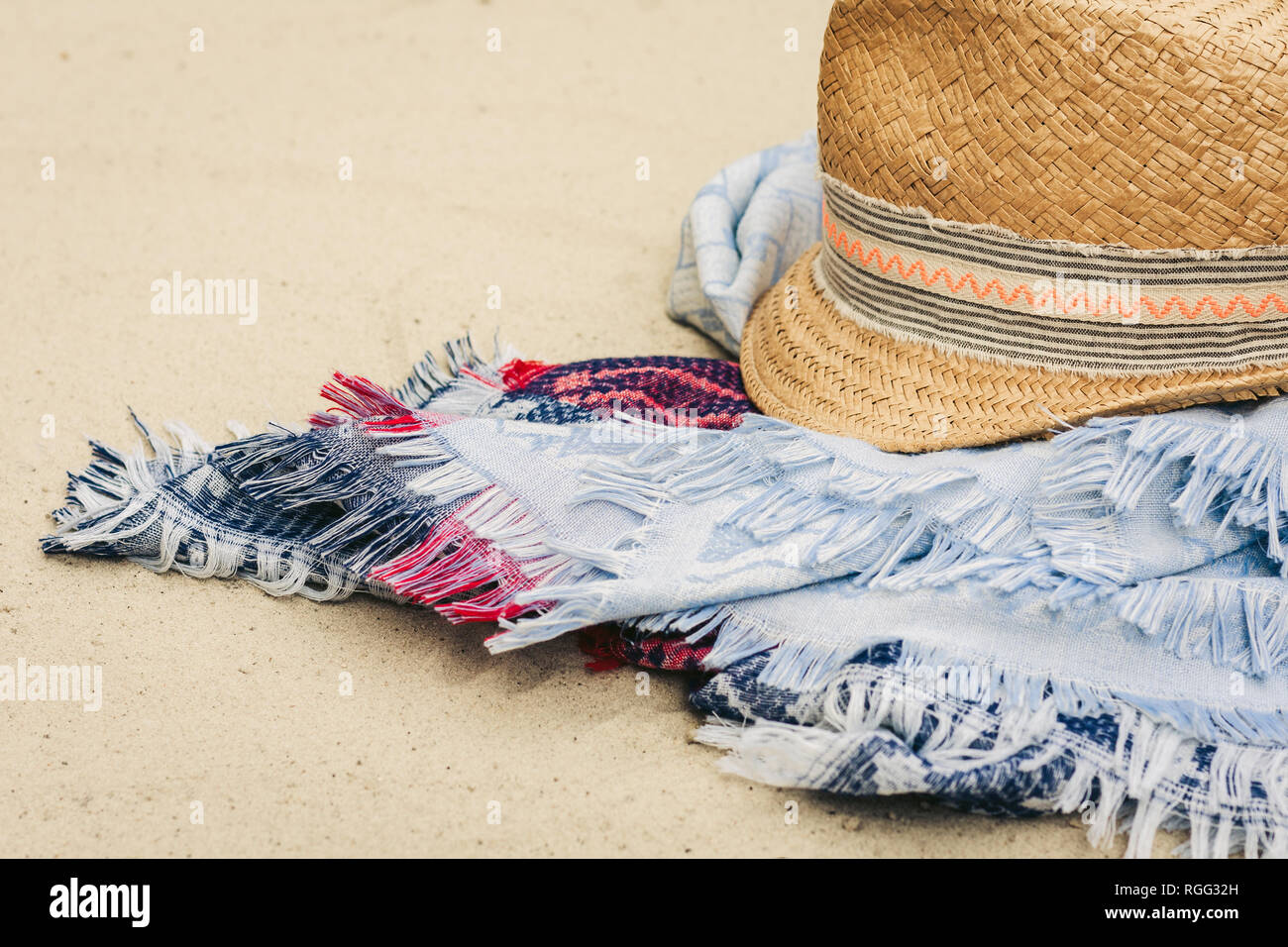 f199a316 Vintage summer wicker straw beach hat and blue pareo on the seashore of  Catania, Sicily, Italy