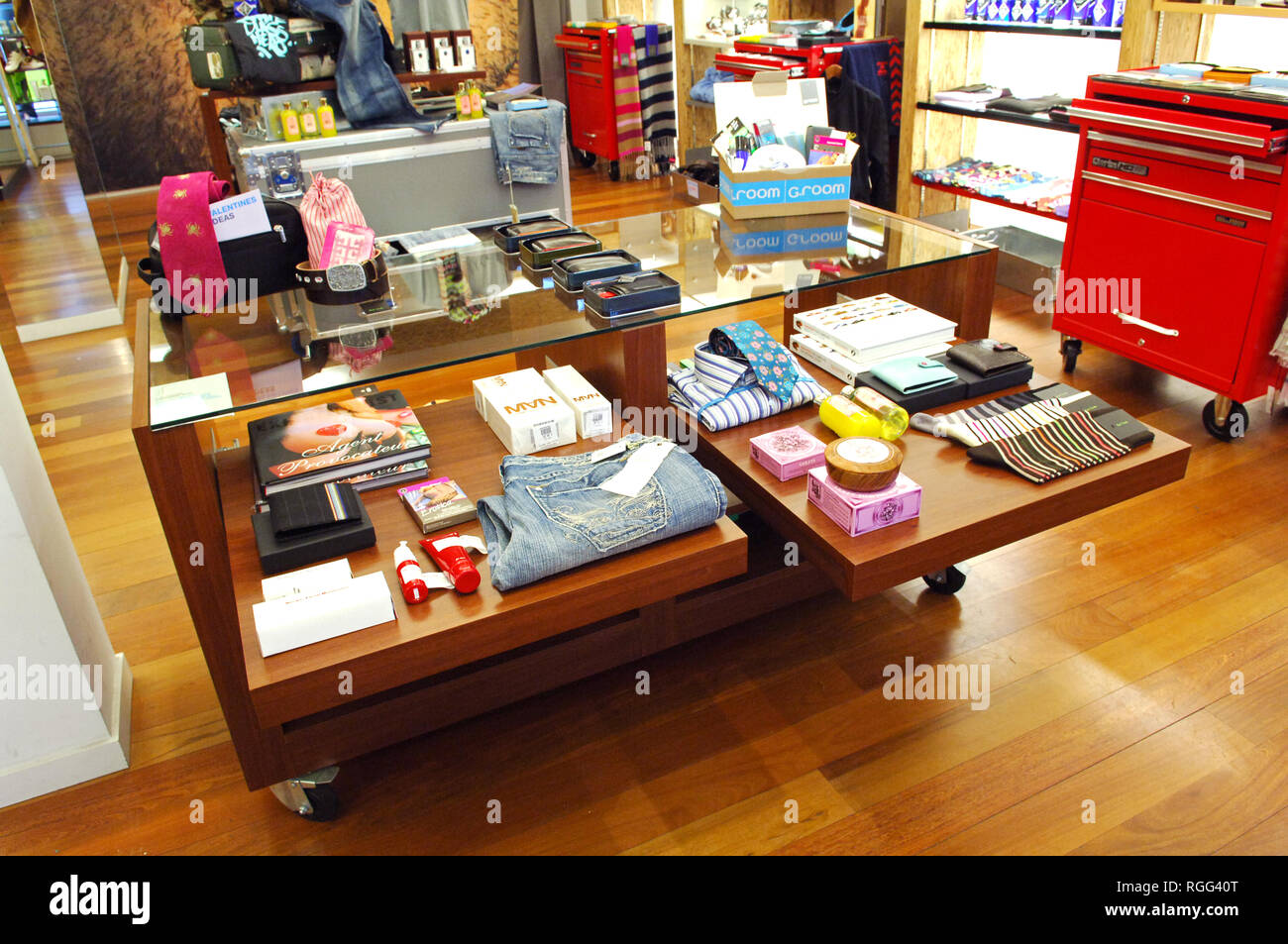 Products for sale in a mens product, beauty and fashion shop - Stock Image
