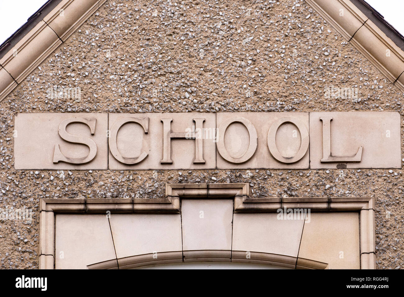 School lettering on outside wall - Stock Image
