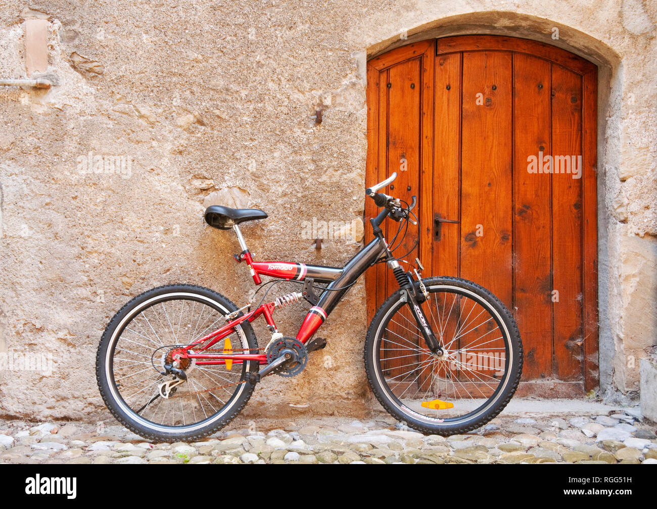 Bicycle leaning against wall in a town along the shores of Lake Geneva, Switzerland Stock Photo