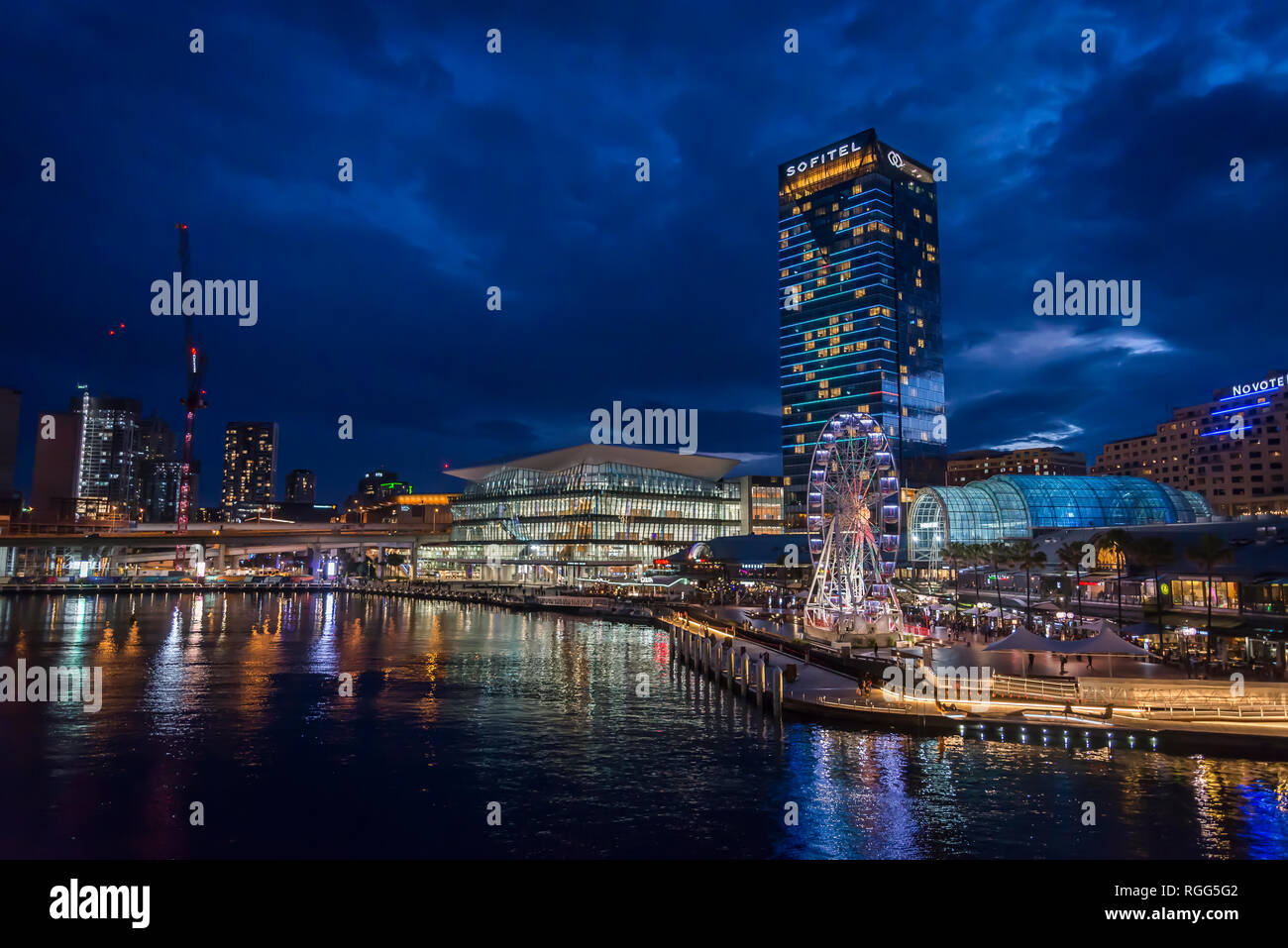 View of Darling Harbour at night with Sofitel Hotel, Sydney, NSW, Australia - Stock Image