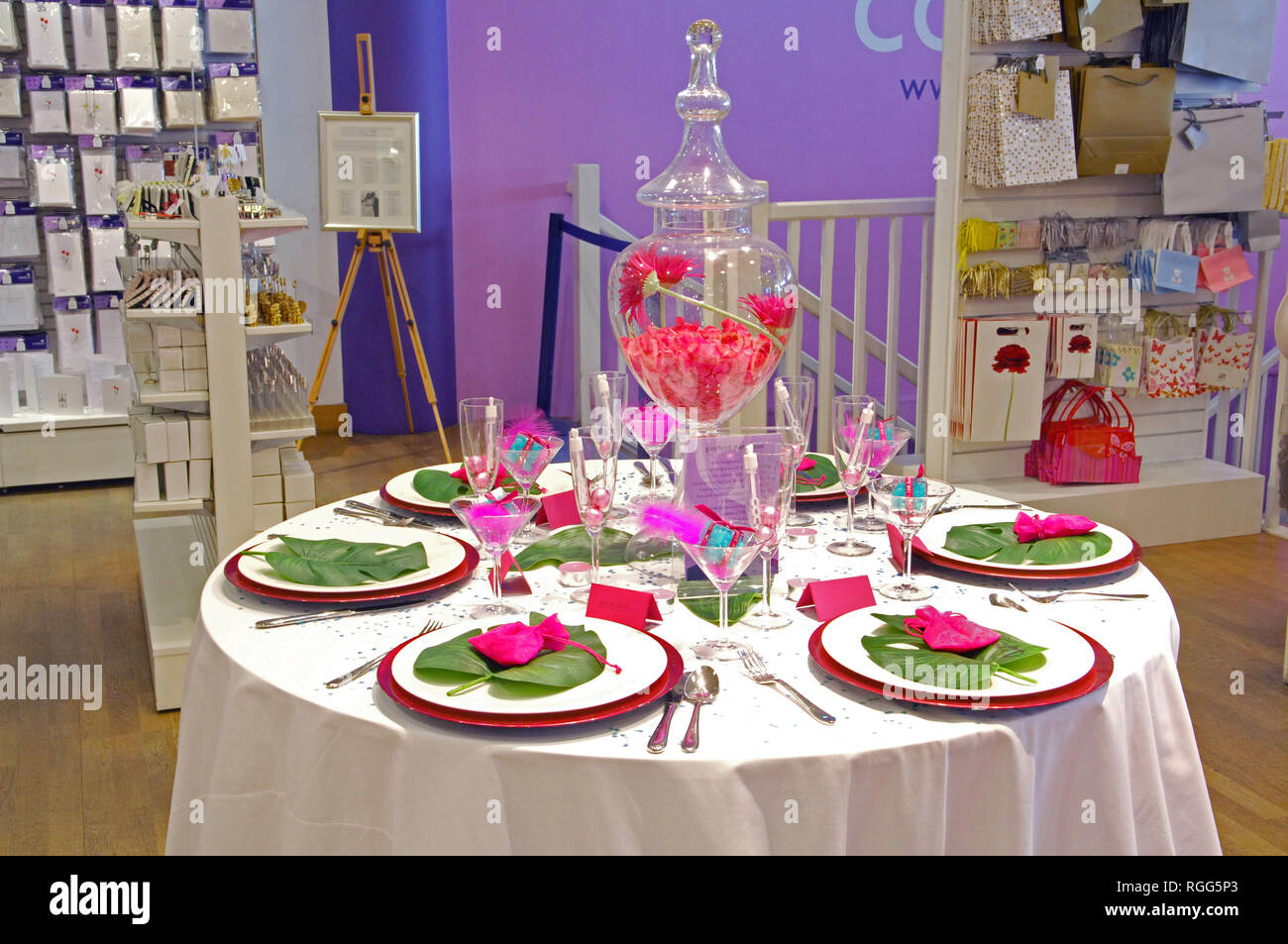 A laid table in a wedding shop - Stock Image