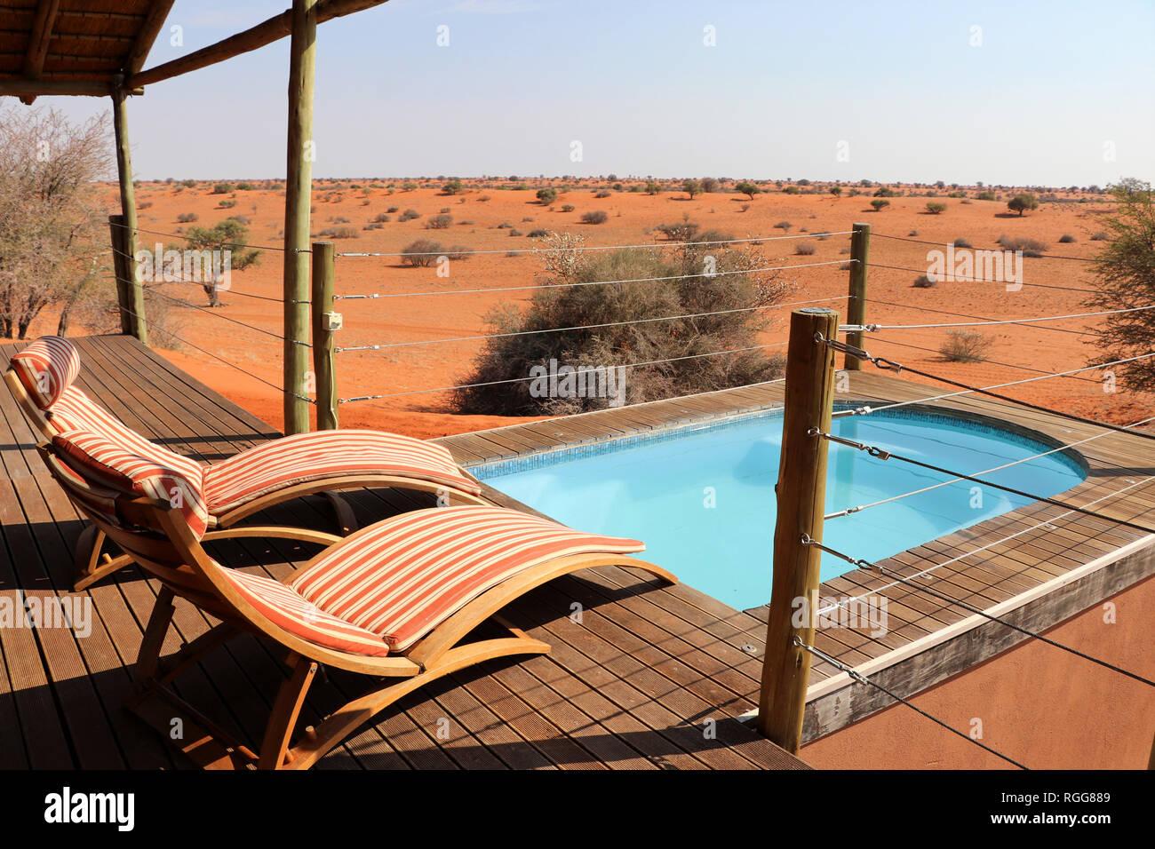 swimming pool with beautiful view in the Kalahari desert – Namibia Africa - Stock Image