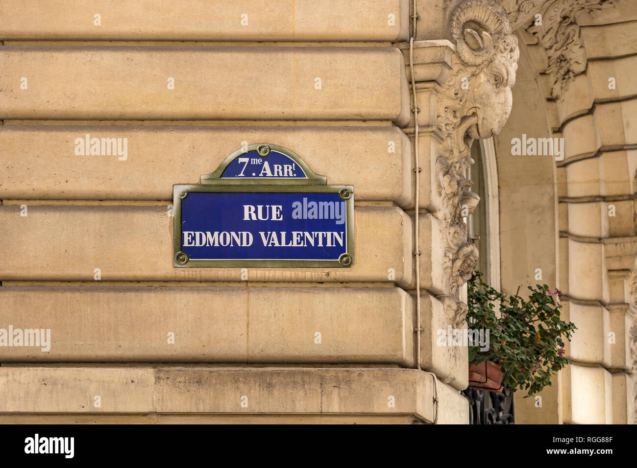 Rue Edmond Valentin Street sign on a stone wall in the 7th arrondissement Paris - Stock Image