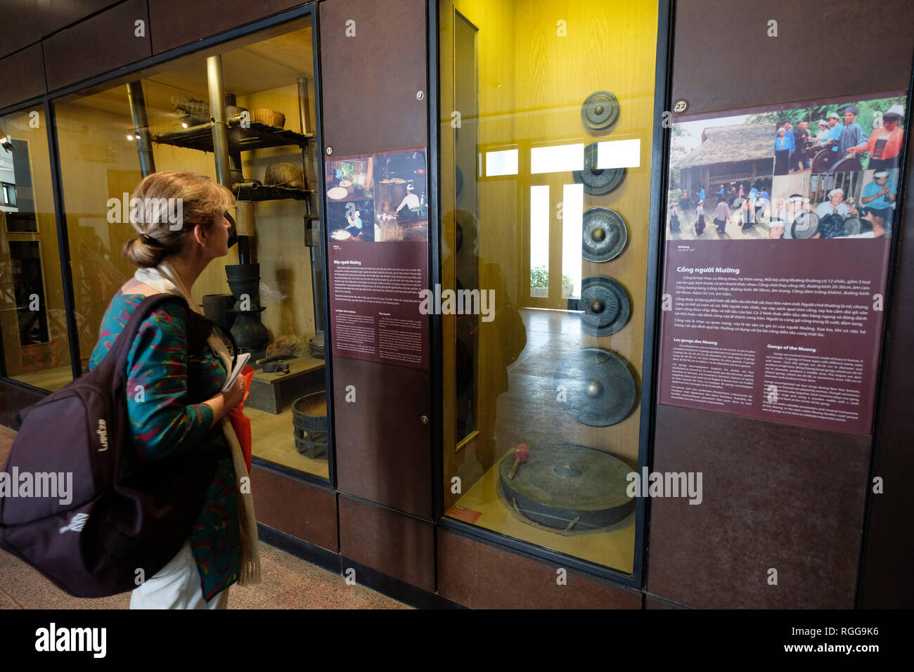Western tourist looking at items made by the Muong people at the Vietnam Museum of Ethnology in Hanoi, Vietnam, Southeast Asia - Stock Image