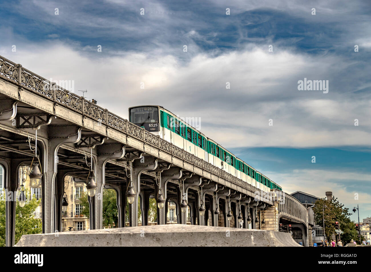 Having just departed Passy station, a Paris Metro Line 6 Metro train crosses Pont de Bir-Hakeim , a two tier viaduct bridge in Paris,France - Stock Image