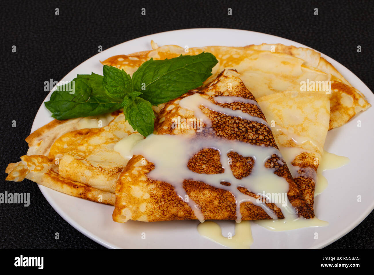Hot Pancake with condensed milk - Stock Image