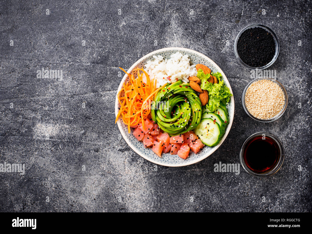 Hawaiian poke bowl with salmon, rice and vegetable - Stock Image