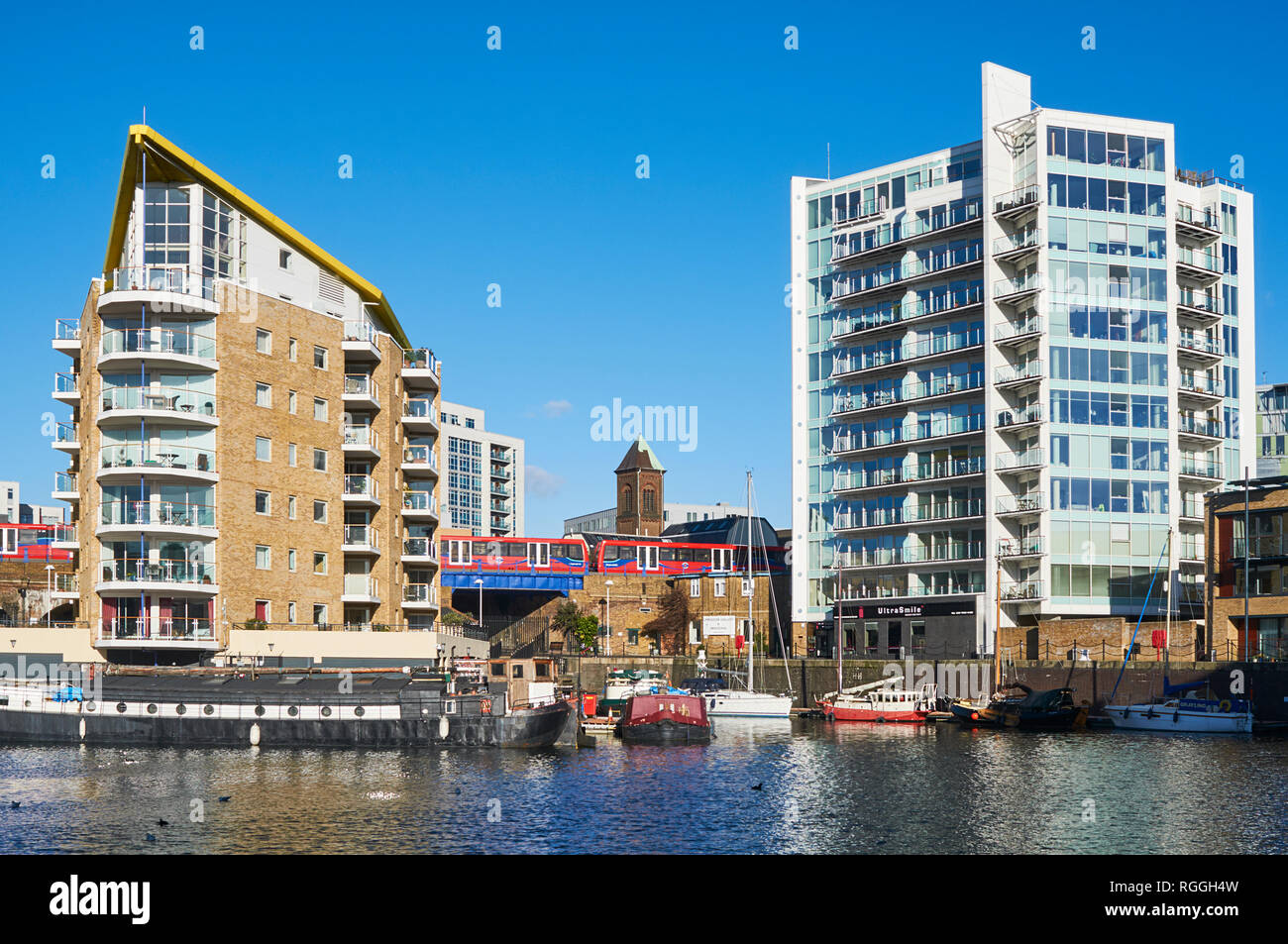 New apartments and the Docklands Light Railway at Limehouse Basin, East London, UK - Stock Image