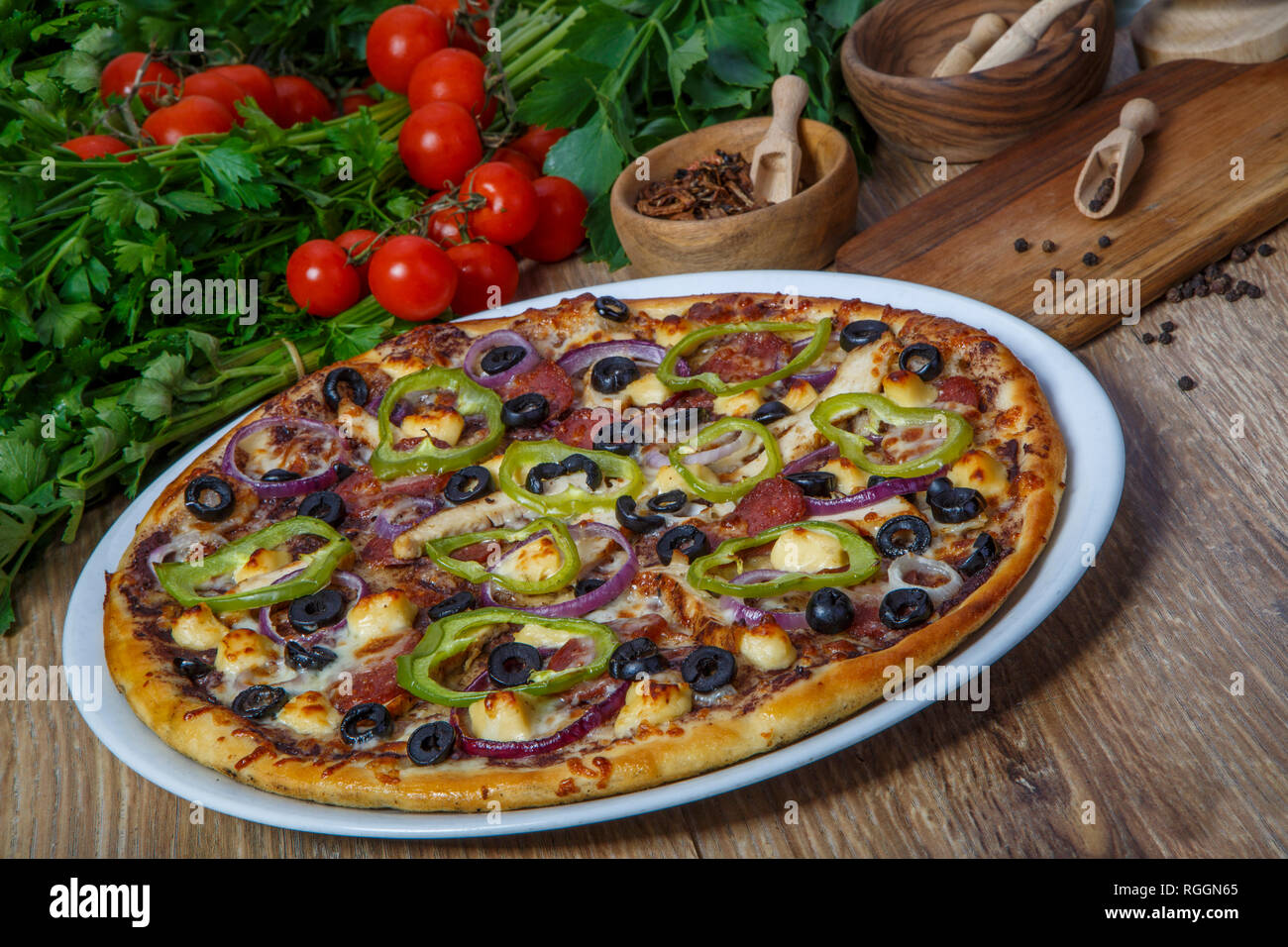 delicious pizza, glass of beer vegetables and spices on wooden table. Top view Stock Photo