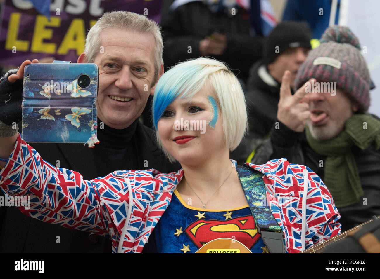EDITORS NOTE GESTURE Anti Brexit campaigner and 'EU Supergirl' Madeleina Kay poses for a selfie outside the Houses of Parliament in London as a crucial debate on Brexit gets underway. - Stock Image