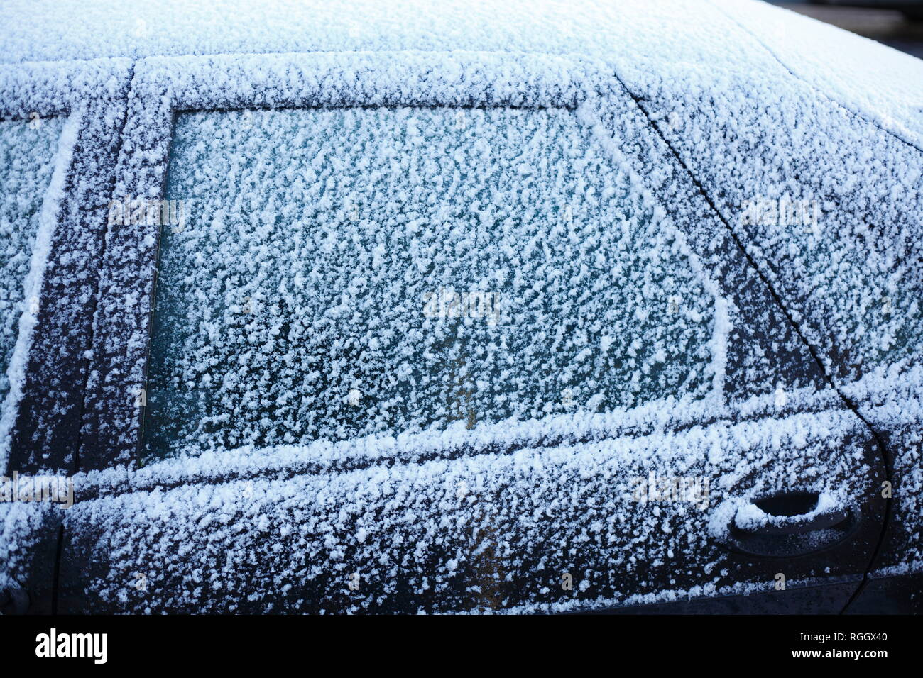 Snowy car window, Germany - Stock Image