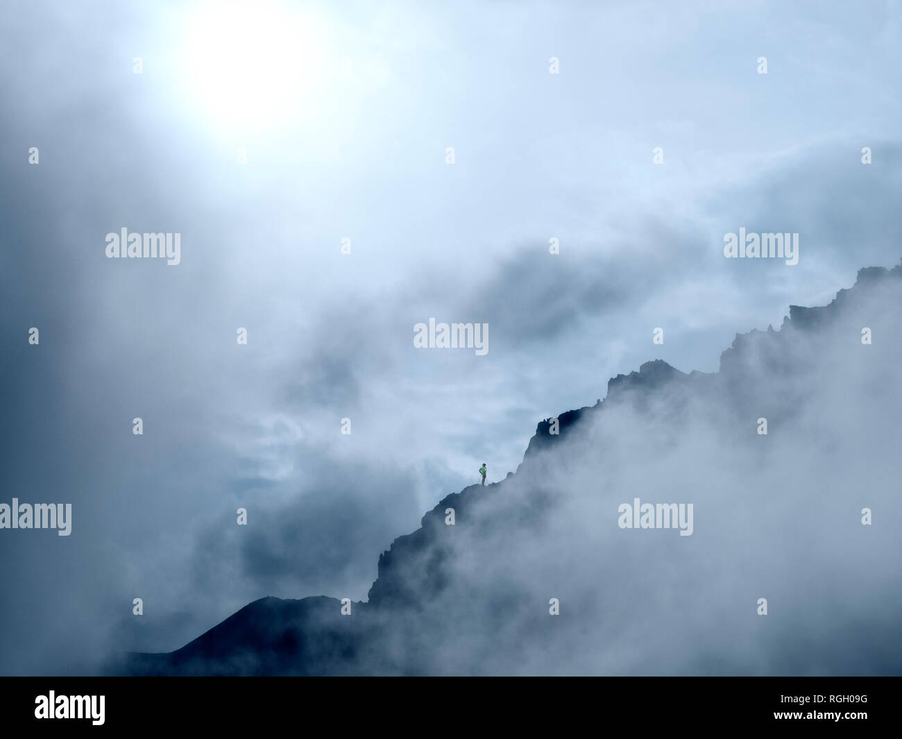 Border region Italy Switzerland, mountain landscape in clouds at Piz Umbrail Stock Photo