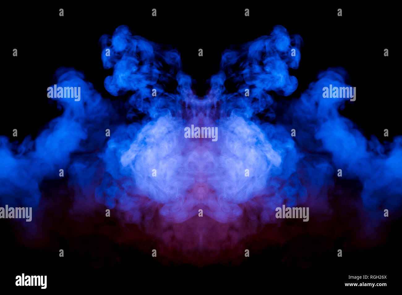 Multicolored curling smoke rising upwards in a pillar, pink blue vapor twisting into abstract shapes and patterns on a black background, repeating the - Stock Image