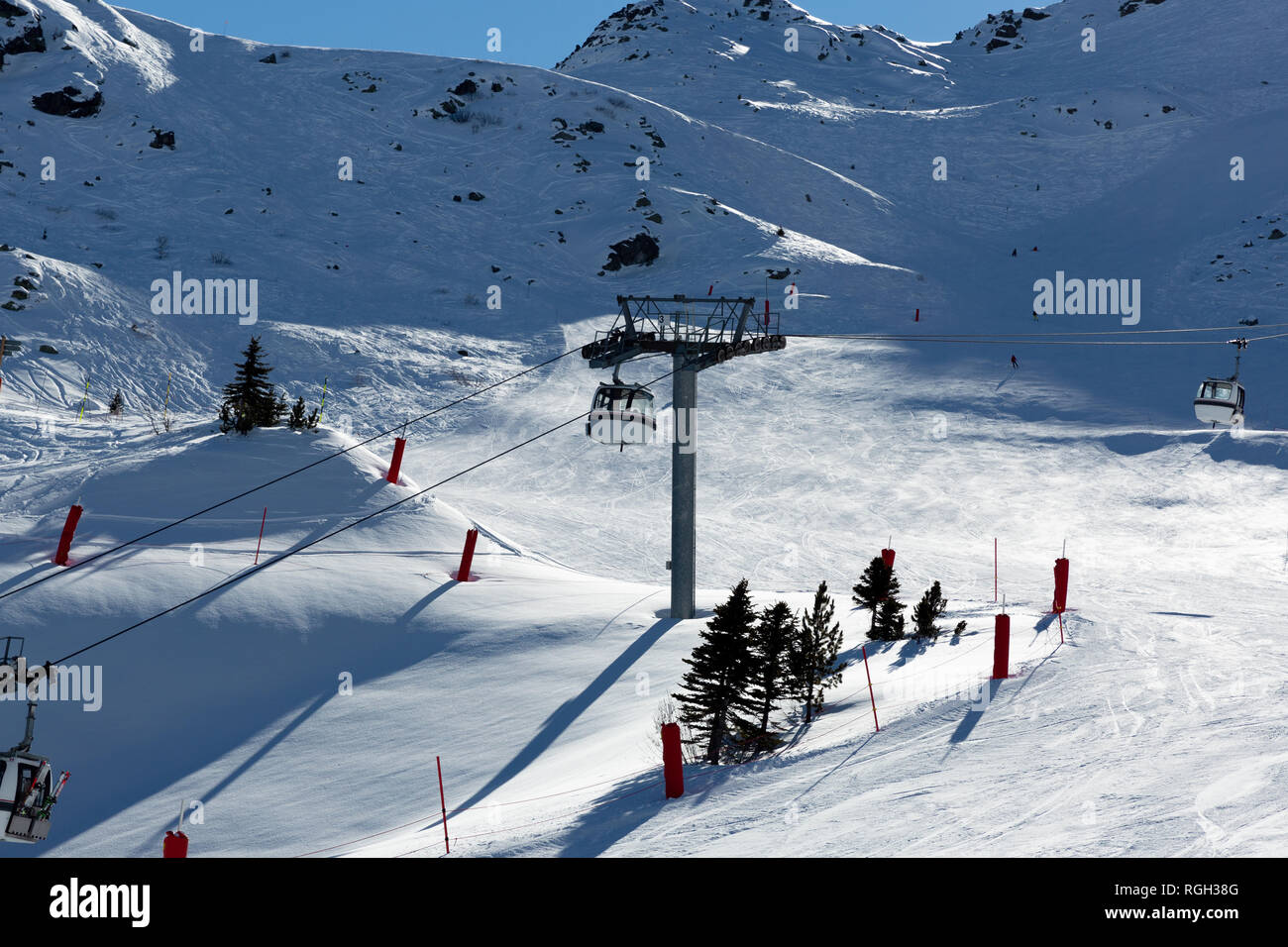 Slope on the skiing resort in Alps, France. Sunny winter day. Winter vacation - Stock Image